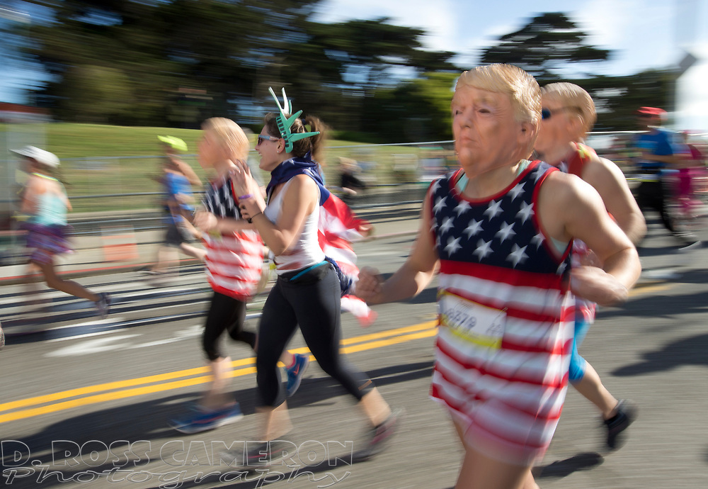 Several runners costumed as Republican presidential candidate Donald J. Trump crest the Hayes Street hill, during the 105th running of the Bay to Breakers 12k, Sunday, May 15, 2016 in San Francisco. The 7.42-mile race from San Francisco Bay to the Pacific Ocean, which attracts a field of tens of thousands of runners, from elite runners to weekend warriors, some clad in costume and some in nothing at all. (D. Ross Cameron/Bay Area News Group)