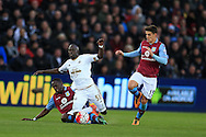 Modou Barrow of Swansea city is fouled by Aly Cissokho of Aston Villa (l) for which the Villa player gets a yellow card. Barclays Premier league match, Swansea city v Aston Villa at the Liberty Stadium in Swansea, South Wales on Saturday 19th March 2016.<br /> pic by  Andrew Orchard, Andrew Orchard sports photography.