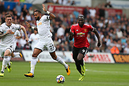 Romelu Lukaku of Manchester Utd breaks away from Kyle Barkley of Swansea city. . Premier league match, Swansea city v Manchester Utd at the Liberty Stadium in Swansea, South Wales on Saturday 19th August 2017.<br /> pic by  Andrew Orchard, Andrew Orchard sports photography.