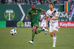 June 15, 2018 - Portland, Oregon, U.S. - PORTLAND, OR - JUNE 15: Portland Timbers forward Fanendo Adi disputes a ball with LA Galaxy defender Dave Romney during  the Portland Timbers game versus the LA Galaxy in a United States Open Cup match on June 15, 2018, at Providence Park, OR. (Photo by Diego G Diaz/Icon Sportswire) (Credit Image: © Diego Diaz/Icon SMI via ZUMA Press)