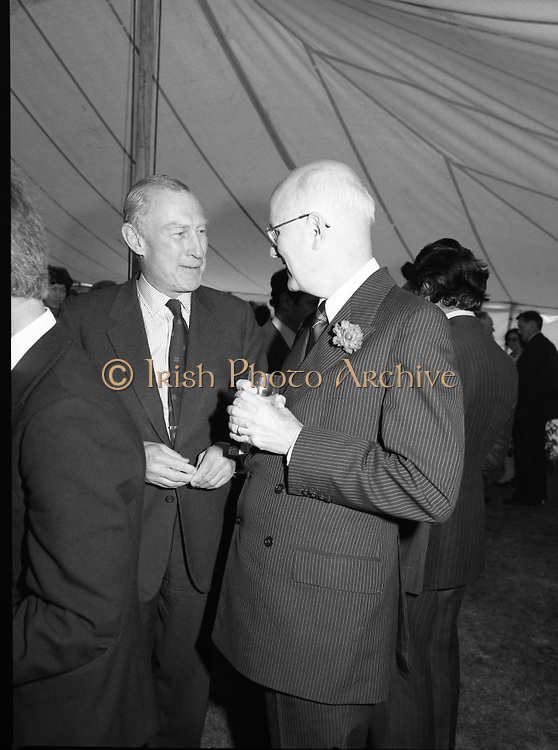 Guests and staff at the US Embassy in Phoenix Park, Dublin, celebrate American Independence Day..1980-07-04.4th July 1980.04/07/1980.07-04-80..Photographed at the US Ambassador's Residence,  Phoenix Park...US Ambassador William V Shannon chats with a guest in the marquee during festivities.