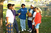 Multiethnic kids age 13 settling dispute.  St Paul Minnesota USA