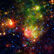The supernova remnant 1E0102.2-7219 sits next to the nebula N76 in a bright, star-forming region of the Small Magellanic Cloud, a satellite galaxy to our Milky Way galaxy located about 200,000 light-years from Earth. Hubble Space Telescope,Spitzer Space Telescope,Chandra X-ray Telescope.