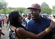 August 23, 2015- Brooklyn, NY-United States:  (L-R) Fashion Entrepreneur Debbe Hardy and Photographer/Cinematographer Shawn Peterson attend the 2015 AFROPUNK Festival on August 23, 2015 held at Commodore Barry Park in Brooklyn, New York City.  AFROPUNK is an influential community of young, gifted people of all backgrounds who speak through music, art, film, comedy, fashion and more. Originating with the 2003 documentary that highlighted a Black presence in the American punk scene, it is a platform for the alternative and experimental.  (Terrence Jennings/terrencejennigs.com)