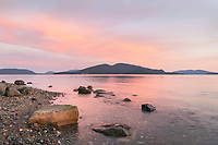 Sunrise over San Juan Islands from Anacortes Washington. Cypress Island is in the distance.