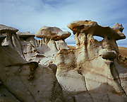 Hoodoos and small arches eroded from the Fruitland Formation, Bisti Badlands, Bisti/De-Na-Zin Wilderness, San Juan Basin, New Mexico.