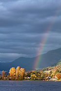 A rainbow over Hatzic Island and Hatzic Lake and near Mission, British Columbia, Canada.  Photographed from Neilson Regional Park in Mission, BC.