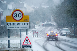 ©  London News Pictures. 18/01/2013. Chieveley, UK. Rush hour traffic driving through treacherous conditions in heavy snowfall in the town of Chieveley, Berkshire on January 18, 2013. A blanket of snow is due to cover the UK causing major travel disruption. Photo credit : Ben Cawthra/LNP