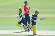 Hampshire wicket keeper-batsman Adam Wheater and Tom Alsop take a run off of Essex bowler Matt Quinn during the Royal London One Day Cup match between Hampshire County Cricket Club and Essex County Cricket Club at the Ageas Bowl, Southampton, United Kingdom on 5 June 2016. Photo by David Vokes.