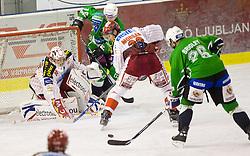 Goalkeeper of KAC Rene Swette, Jason Morgan of KAC vs Travis Brigley of Olimpija at ice-hockey match in 33rd Round of EBEL league between HDD Tilia Olimpija Ljubljana and EC KAC, Klagenfurt, on December 18, 2009, in Arena Tivoli, Ljubljana, Slovenia. Olimpija defeated KAC 4:2. (Photo by Vid Ponikvar / Sportida)