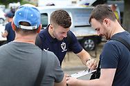 AFC Wimbledon defender Jon Meades (3) arriving and signing autographs during the Pre-Season Friendly match between AFC Wimbledon and Queens Park Rangers at the Cherry Red Records Stadium, Kingston, England on 14 July 2018. Picture by Matthew Redman.