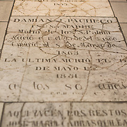 Grave markers on the floor of the nave in the Oratorio San Felipe Neri in the heart of the historic Casco Viejo neighborhood of Panama City, Panama. It is one of the oldest churches in the city and was inaugurated in 1688.