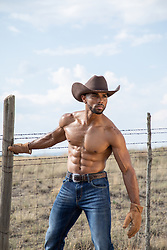 hot shirtless muscular cowboy on a ranch hot cowboy sitting on a fence at a ranch