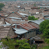 A sea of thatched and tin roofs cover shanties in the huge slum of Belen in Iquitos, Peru.