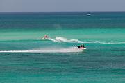 People ride jet skis  in Nassau, Bahamas.