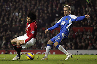 Photo: Paul Thomas.<br /> Manchester United v Wigan Athletic. The Barclays Premiership. 26/12/2006.<br /> <br /> Gary Teale (R) fouls Ji-sung Park to give Utd a penalty kick.