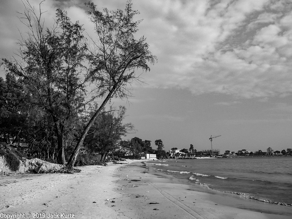 "12 FEBRUARY 2019 - SIHANOUKVILLE, CAMBODIA: The Blue Bay beach. Blue Bay is a Chinese casino and resort being built in Sihanoukville. There are about 50 Chinese casinos and resort hotels either open or under construction in Sihanoukville. The casinos are changing the city, once a sleepy port on Southeast Asia's ""backpacker trail"" into a booming city. The change is coming with a cost though. Many Cambodian residents of Sihanoukville  have lost their homes to make way for the casinos and the jobs are going to Chinese workers, brought in to build casinos and work in the casinos.       PHOTO BY JACK KURTZ"
