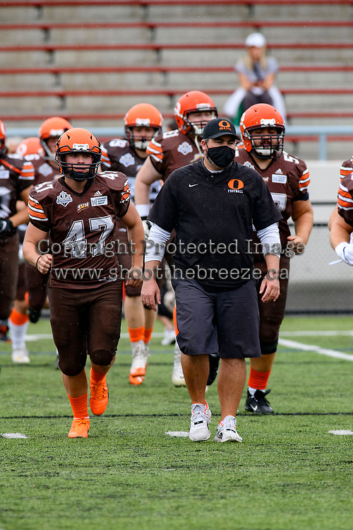 CHILLIWACK, BC - SEPTEMBER 11: Jamie Boreham, head coach of the Okanagan Sun leads his team on to the field at the start of the homeopener against the Westshore Rebels at Exhibition Stadium in Chilliwack, BC, Canada. (Photo by Marissa Baecker/Shoot the Breeze)