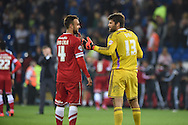 Dimi Konstantopoulos , the Middlesbrough goalkeeper ® chats to Juan Cala of Cardiff city at the end of the match.Skybet football league championship match, Cardiff city v Middlesbrough at the Cardiff city stadium in Cardiff, South Wales on Tuesday 16th Sept 2014<br /> pic by Andrew Orchard, Andrew Orchard sports photography.