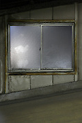 dirty window in parking garage at night