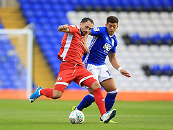 Birmingham City's Che Adams (right) and Crawley Town's Josh Payne battle for the ball