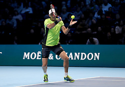 Horia Tecau plays a shot during his doubles match with team mate Jean -Julian Rojer against Pierre Hugues Herbert and Nicolas Mahut during day one of the NITTO ATP World Tour Finals at the O2 Arena, London.