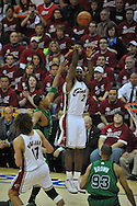 LeBron James of Cleveland puts up a shot over the Boston defense..The Cleveland Cavaliers defeated the Boston Celtics 88-77 in Game 4 of the Eastern Conference Semi-Finals at Quicken Loans Arena in Cleveland.