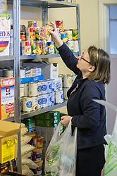 A volunteer working in a food bank.