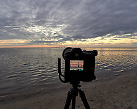 Cameras set up to photograph the sun rising under the Sunshine Skyway bridge from Fort De Soto Park in Pinellas County, Florida. Image taken with a Leica T camera and 11-23 mm wide-angle zoom lens
