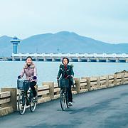 Two girls riding bikes close to Nampo dan.