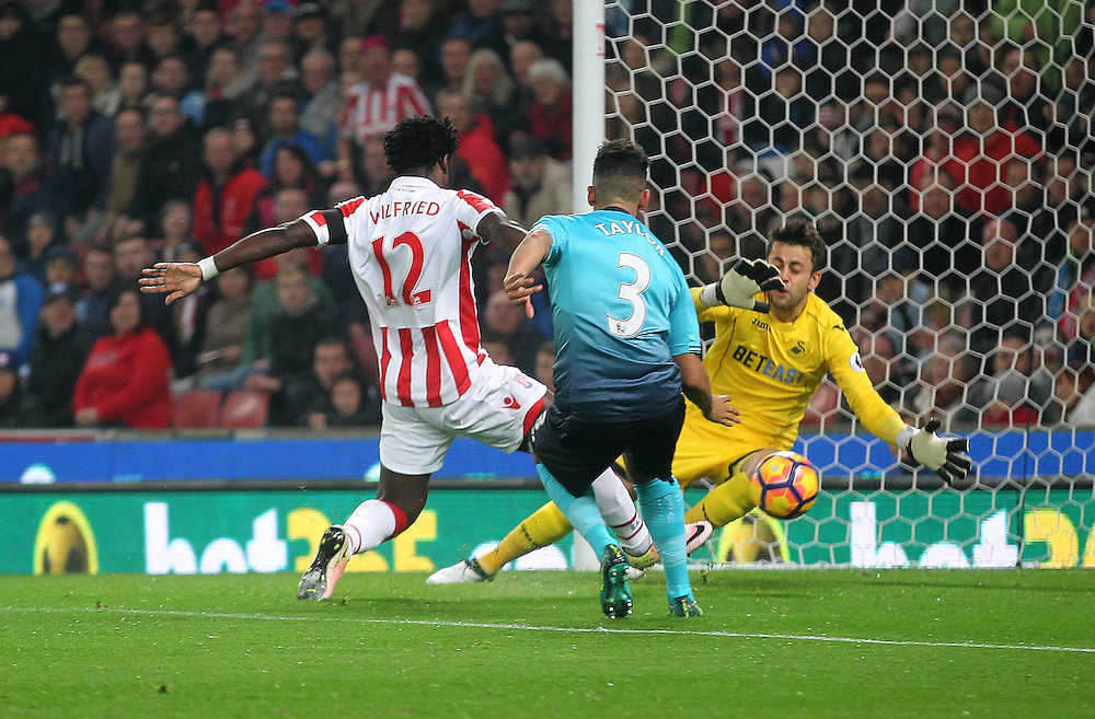Stoke City's Wilfried Bony scores his sides first goal   beating Swansea City's Lukasz Fabianski<br /> <br /> Photographer Mick Walker/CameraSport<br /> <br /> The Premier League - Stoke City v Swansea City - Monday 31st October 2016 -  bet365 Stadium - Stoke-on-Trent<br /> <br /> World Copyright © 2016 CameraSport. All rights reserved. 43 Linden Ave. Countesthorpe. Leicester. England. LE8 5PG - Tel: +44 (0) 116 277 4147 - admin@camerasport.com - www.camerasport.com
