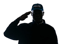 Close-up of an Afro American policeman saluting in studio on white isolated background