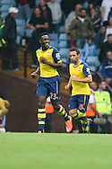 Danny Welbeck of Arsenal (left) celebrates scoring his side's second goal. Barclays Premier league match, Aston Villa v Arsenal at Villa Park in Birmingham on Saturday 20th Sept 2014<br /> pic by Mark Hawkins, Andrew Orchard sports photography.