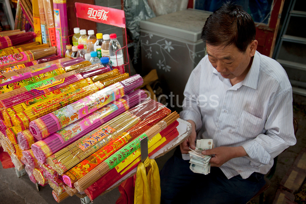 "Incense sticks for sale outside Yonghe Temple, also known as the ""Palace of Peace and Harmony Lama Temple"", the ""Yonghe Lamasery"", or - popularly - the ""Lama Temple"" is a temple and monastery of the Geluk School of Tibetan Buddhism located in the northeastern part of Beijing, China. It is one of the largest and most important Tibetan Buddhist monasteries in the world. The building and the artworks of the temple is a combination of Han Chinese and Tibetan styles."