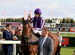 Saxon Warrior ridden by Ryan Moore enters the winners enclosure after winning the Racing Post Trophy Stakes during Racing Post Trophy day at Doncaster Racecourse.