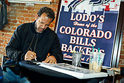 SHOT 12/10/17 12:24:25 PM - Former Buffalo Bills wide receiver and Hall of Fame player Andre Reed signs autographs and meets with fans at LoDo's Bar and Grill in Denver, Co. as the Buffalo Bills played the Indianapolis Colts that Sunday. Reed played wide receiver in the National Football League for 16 seasons, 15 with the Buffalo Bills and one with the Washington Redskins. (Photo by Marc Piscotty / © 2017)