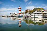 Boats and Harbour Town Lighthouse at Sea Pines Resort Hilton Head Island, GA.