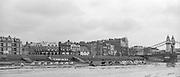 London. United Kingdom. Crews approaching Hammersmith Bridge,  1987 Pre Fixture, Varsity Boat Race. National Squad vs Cambridge University BC, crews approaching Hammersmith Bridge, on the Championship Course Mortlake to Putney. River Thames.  Saturday 21.03.1987<br /> <br /> [Mandatory Credit: Peter SPURRIER/Intersport images]<br /> <br /> National Squad, Bow, Terry Dillon, John MAXEY, John GARRETT, Martin CROSS, Andy HOLMES, Steve REDGRAVE, Adam CLIFT, Richard STANHOPE and Cox, Pat SWEENEY.<br /> <br /> CUBC.  Crew Bow. Ian CLARKE, Richard SPINK, Nicholas GRUNDY, Matt BRITTIN, Stephen PEEL [PRESIDENT] Jim PEW, Jim GARMAN, Paddy BROUGHTON and Cox. Julian WOLFSON 19870321 Pre Boat Race fixture, National Squard vs Cambridge UBC, London UK