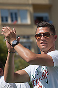 The portuguese team captain Cristiano Ronaldo speaking to the crowd of portuguese supporters at Alameda Dom Afonso Henriques, in Lisbon. Portugal's national squad won the Euro Cup the day before, beating in the final France, the organizing country of the European Football Championship, in a match that ended 1-0 after extra-time.