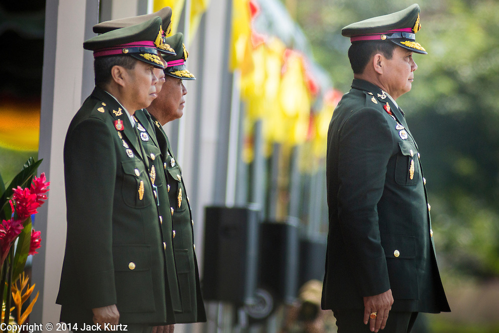 29 SEPTEMBER 2014 - NAKHON NAYOK, NAKHON NAYOK, THAILAND: General PRAYUTH CHAN-OCHA (right) reviews Thai soldiers at the retirement ceremony for Prayuth and 200 other generals. Gen. Prayuth Chan-ocha led the 22 May coup against the civilian government earlier this year. Prayuth has been chief of the Thai army since 2010. After his retirement, Gen. Prayuth will retain his posts as head of the junta's National Council for Peace and Order (NCPO) and Prime Minister of Thailand. Under Thai law, military officers must retire at 60 years of age. The 200 generals who retired with Prayuth were also his classmates at the Chulalomklao Royal Military Academy in Nakhon Nayok.    PHOTO BY JACK KURTZ
