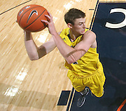 CHARLOTTESVILLE, VA- NOVEMBER 29: Stu Douglass #1 of the Michigan Wolverines grabs the rebound during the game on November 29, 2011 at the John Paul Jones Arena in Charlottesville, Virginia. Virginia defeated Michigan 70-58. (Photo by Andrew Shurtleff/Getty Images) *** Local Caption *** Stu Douglass