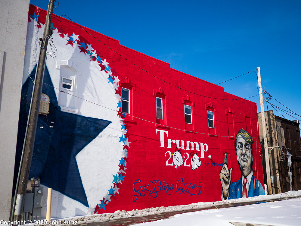 01 FEBRUARY 2020 - BOONE, IOWA: A mural supporting President Donald Trump in downtown Boone, IA. Carl McKnight, a Boone realtor and Donald Trump supporter, commissioned the mural, which he calls nothing more than a campaign sign. Some in Boone, a community about 45 miles northwest of Des Moines, are concerned that the mural, which dominates a new park and bandshell in Boone, is not appropriate in a space shared by all people. A Boone city councilperson said people who donated to the fund to build the park have asked for their donations back. McKnight said the mural will stay up until at least election day.    PHOTO BY JACK KURTZ