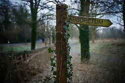 Wooden signpost, The Arboretum, Shady Lane, Evington Village, Leicester, England, UK.