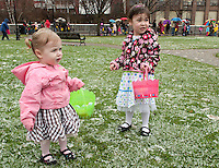 The snow did not stop Brooklyn and Brianna Dame from getting all dressed up in their Easter finery for the Easter Eggstravaganza Egg Hunt at Laconia Rotary Park Saturday afternoon.   (Karen Bobotas/for the Laconia Daily Sun)