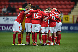 Charlton Athletic's players huddle before kick off