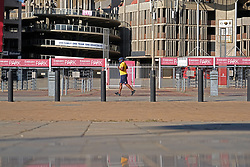 JOHANNESBURG, SOUTH AFRICA - MAY 10: A man exercising in Ellis Park during lockdown level 4 on May 10, 2020 in Johannesburg, South Africa. According to media reports, during lockdown level 4 people are allowed to exercise. Guidelines allow for cycling, running and walking as examples and must be within a 5km radius of their residences between 6:00 am – 9:00 am. (Photo by Dino Lloyd)