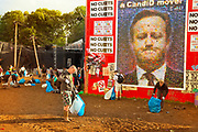 Glastonbury Festival, 2015. Shangri La is a festival of contemporary performing arts held each year within Glastonbury Festival. The theme for the 2015 Shangri La was Protest. <br /> 6am end of the party; volunteer workers clearing up all the dropped rubbish from the mud.