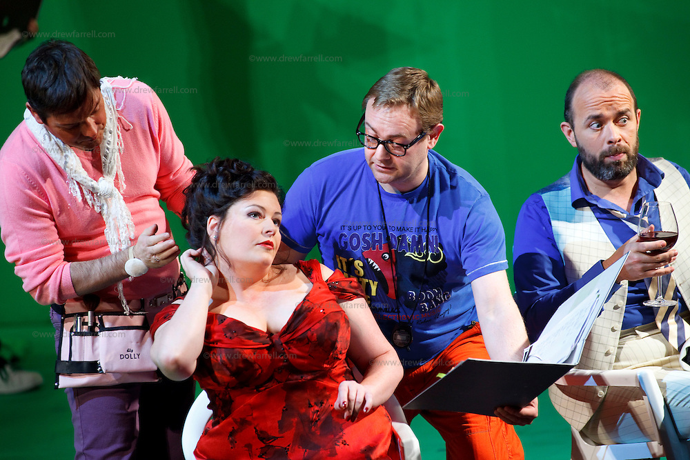 Picture shows : Karen Cargill as Isabella (seated) and  Adrian Powter as Taddeo (with wine)..Picture  ©  Drew Farrell Tel : 07721 -735041..A new Scottish Opera production of  Rossini's 'The Italian Girl in Algiers' opens at The Theatre Royal Glasgow on Wednesday 21st October 2009..(Soap) opera as you've never seen it before..Tonight on Algiers.....Colin McColl's cheeky take on Rossini's comic opera is a riot of bunny girls, beach balls, and small screen heroes with big screen egos. Set in a TV studio during the filming of popular Latino soap, Algiers, the show pits Rossini's typically playful and lyrical music against the shoreline shenanigans of cast and crew. You'd think the scandal would be confined to the outrageous storylines, but there's as much action off set as there is on.....Italian bass Tiziano Bracci makes his UK debut in the role of Mustafa. Scottish mezzo-soprano Karen Cargill, who the Guardian called a 'bright star' for her performance as Rosina in Scottish Opera's 2007 production of The Barber of Seville, sings Isabella..Cast .Mustafa...Tiziano Bracci.Isabella..Karen Cargill.Lindoro...Thomas Walker.Elvira...Mary O'Sullivan.Zulma...Julia Riley.Haly...Paul Carey Jones.Taddeo...Adrian Powter..Conductors.Wyn Davies.Derek Clarke (Nov 14)..Director by Colin McColl.Set and Lighting Designer by Tony Rabbit.Costume Designer by Nic Smillie..New co-production with New Zealand Opera.Production supported by.The Scottish Opera Syndicate.Sung in Italian with English supertitles..Performances.Theatre Royal, Glasgow - October 21, 25,29,31..Eden Court, Inverness - November 7. .His Majesty's Theatre, Aberdeen  - November 14..Festival Theatre,Edinburgh - November 21, 25, 27 ...Note to Editors:  This image is free to be used editorially in the promotion of Scottish Opera. Without prejudice ALL other licences without prior consent will be deemed a breach of copyright under the 1988. Copyright Design and Patents Act  and will be subject to payment or legal action, wher