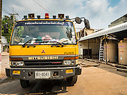 16 MARCH 2016 - PRACHIN BURI, PRACHIN BURI, THAILAND: A worker at Abhaibhubet Hospital in Prachin Buri,  refills water tanks from a water truck. The drought in Thailand is worsening and has spread to 14 provinces in the agricultural heartland of Thailand. Communities along the Bang Pakong River, which flows into the Gulf of Siam, have been especially hard hit since salt water has intruded into domestic water supplies as far upstream as Prachin Buri, about 100 miles from the mouth of the river at the Gulf of Siam. Water is being trucked to hospitals in the area because they can't use the salty water.        PHOTO BY JACK KURTZ