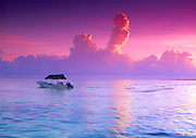 Fishing boat with a palapa roof at sunrise on the Gulf of Mexico waters on the coast of Isla de Holbox, Mexcio